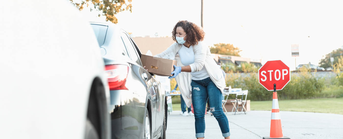 iStock-1282319752-Lady handing over click and collect package